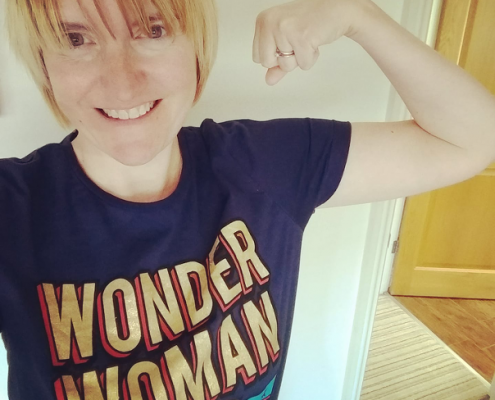 Photograph of Tara Luke wearing a wonder woman t-shirt